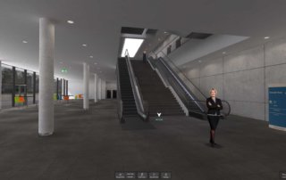 View from alpha floor into the beta floor. Users are able to move around freely with the mouse or teleport to destinations with the buttons on the bottom of the screen.